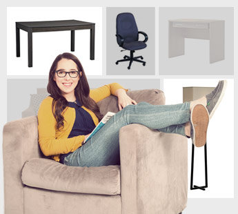 Young woman with brown hair and glasses wearing jeans and a yellow sweater holding a book while lounging on an armchair