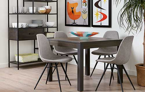 Dorian square black dining table with light gray Keagan dining chairs with metal legs