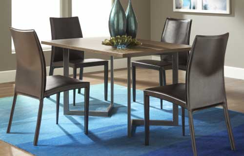 Brown wooden dining table with four dining chairs on a blue area rug