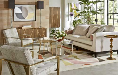 Light-colored Conway signature sofa and Warner chairs with marbled upholstery and metal armrests in brightly lit living room