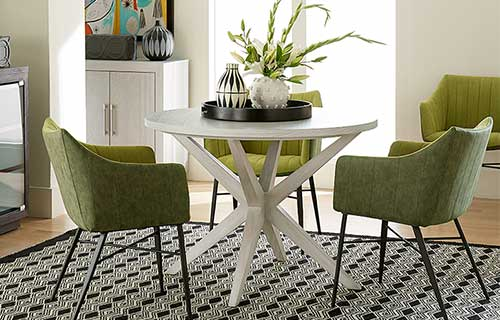 Solstice white wooden dining table with green Bixby dining chairs
