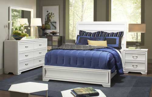 White wooden bedroom set with blue duvet