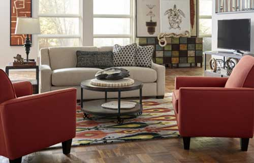 Living room arrangement with red chairs and a circular coffee table.