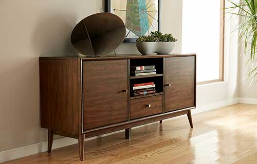Hendrick Mid-Century Danish Modern credenza console table in sunny living room with a wooden floor