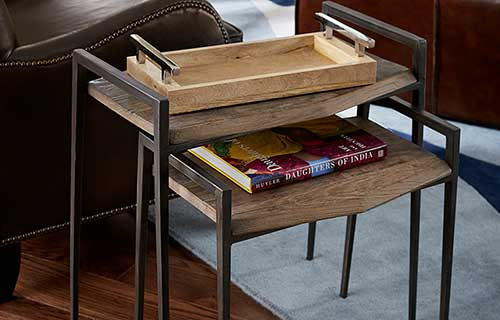 Wood and metal Penn nesting tables by CORT Furniture Rental