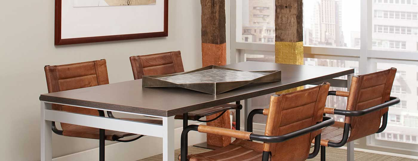 Staks conference table with leather Gianni chairs in front of a window in a private office space