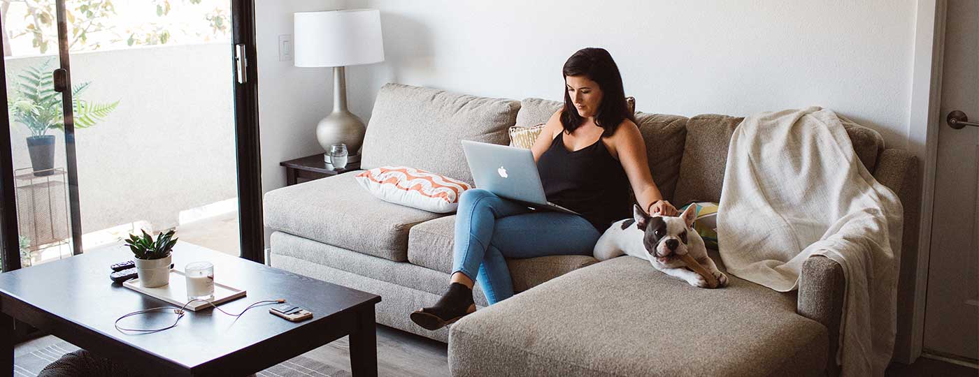 Entrepreneur working from home on furniture she rented from CORT