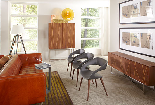 Elegant office lobby furnished with brown leather Harrison sofa and Shadow and Shape chairs by CORT