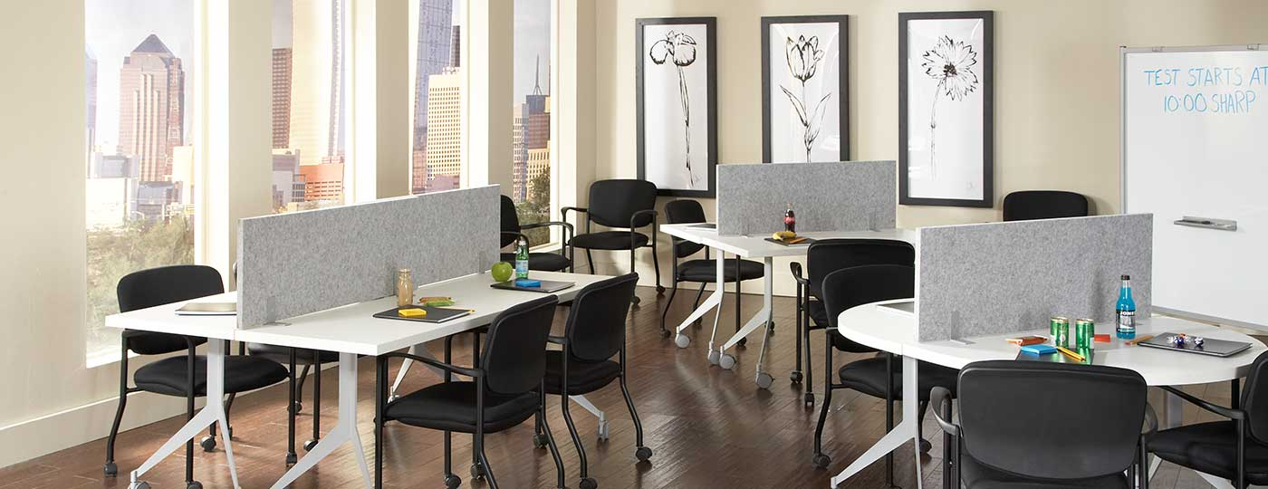 Staks workplace chairs and paneling systems in an office training room