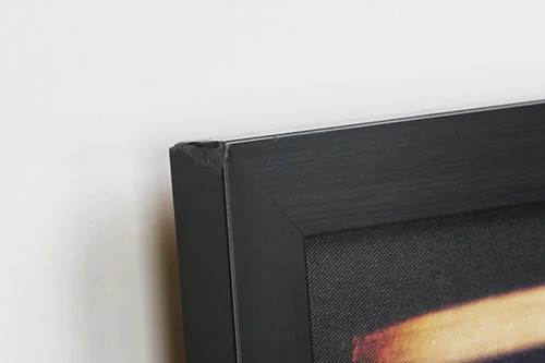 Used artwork with small dented corner frame