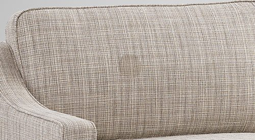 Bargain sofa with noticeable round stain on back cushion