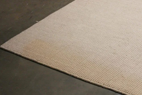 Bargain rug with large stain