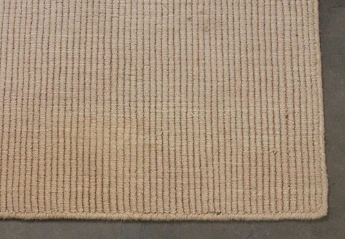 Used rug with light stain