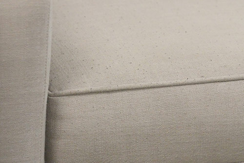 Used sofa with small pilling on cushion